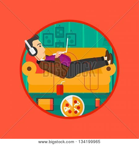 Man with belly relaxing on a sofa with many gadgets. Man lying on a sofa surrounded by gadgets. Man using gadgets at home. Vector flat design illustration in the circle isolated on background.