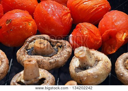 Champignon White Mushrooms And Tomatoes On Grill