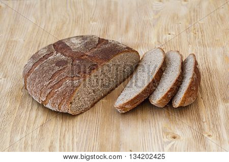 Fresh sliced rye bread on a rustic wooden table