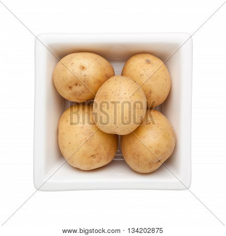 Baby potatoes in a square bowl isolated on white background