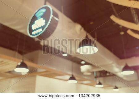Restaurant blur background with bokeh of lamplight Blur scene.