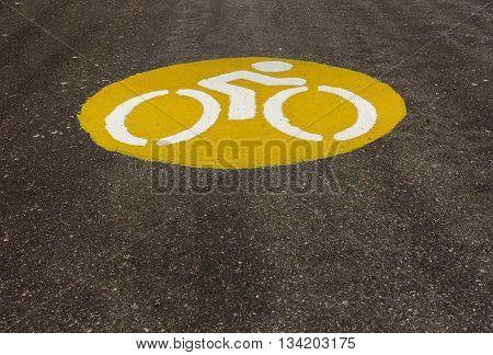 Symbol of bike lane and asphalt paving.