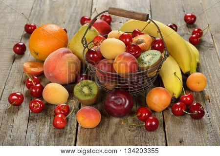Fresh various fruits on wooden background close up
