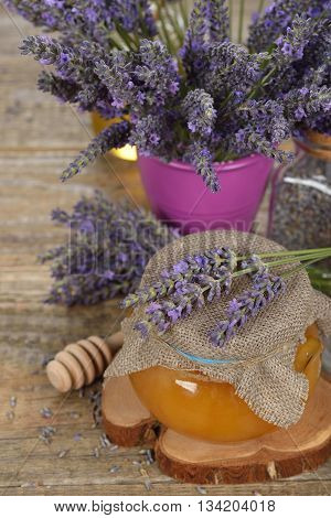 Lavender honey on a wooden background close up