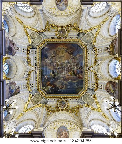 Madrid Spain - November 27 2015: The fresco Corrado Giaquinto (Spain Pays Homage to Religion and to the Church) on the vaulted ceiling in the Royal Palace of Madrid. It is popular tourist attraction.
