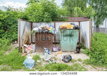 Orel, Russia - June 02, 2016: Garbage in the trash containers near the entrance to the Center for Hygiene and Epidemiology in the Oryol region
