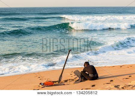 Diver spear fishing gun goggles line bouy beach entry swim into ocean