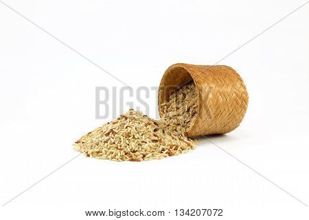 Raw Brown rice in bamboo box (Kratip) on white background
