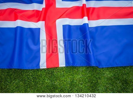 Flags of Iceland on green grass