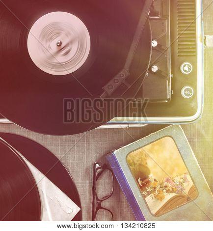 The vintage player of vinyl records retro toning