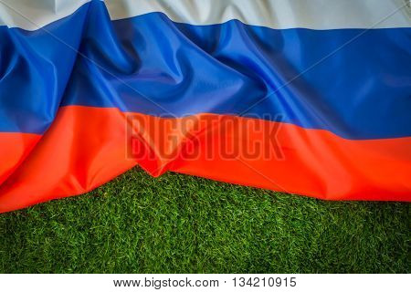 Flags of Russia on green grass