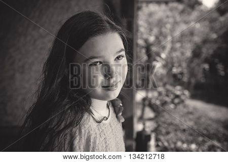 Black and white (monochrome) portrait of a pensive teen girl