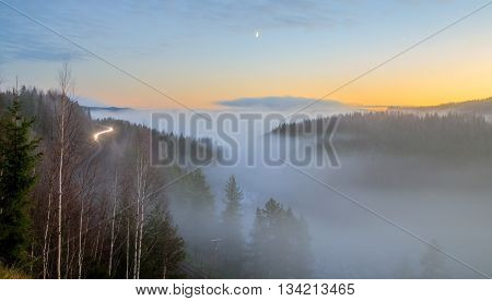 mountain forest landscape with railroad in sun light
