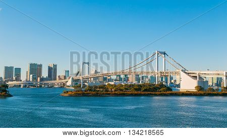 High rises and cityscape with Rainbow bridge in Tokyo Japan