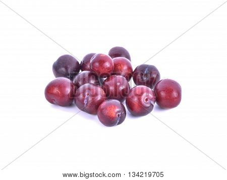 Plums close up isolated on white background