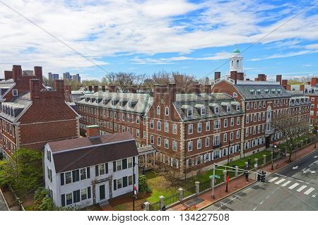Cambridge, USA - April 29, 2015: Aerial view on John F Kennedy Street in Harvard University Area in Cambridge Massachusetts the USA. Eliot House white belltower seen on the background. Tourists in the street
