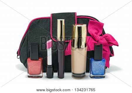 Black bag for cosmetics and accessories with a pink bow and a set of cosmetics for the face isolated on a white background