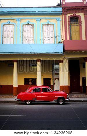 old red car in cuban backstreet, havana