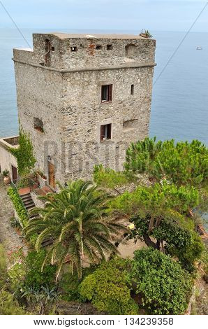 ancient genovese tower with garden on seafront