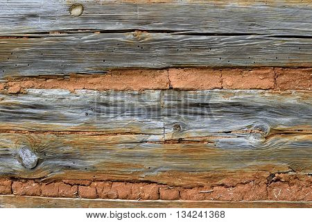 Old wood and brick wall background at historic building