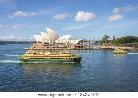 SYDNEY, AUSTRALIA - APRIL 20: View on famous Syndey Opera House and ferries in daylight. April 2016
