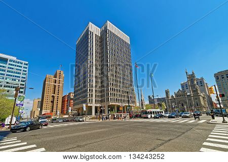Municipal Services Building and skyscrapers in Philadelphia Pennsylvania USA. It is central business district in Philadelphia. Road view. Tourists in the street.