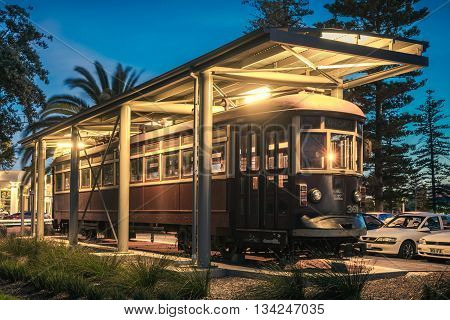 Adelaide Australia - November 8 2014: Historic red rattler tram in Glenelg on a permanent display at night time