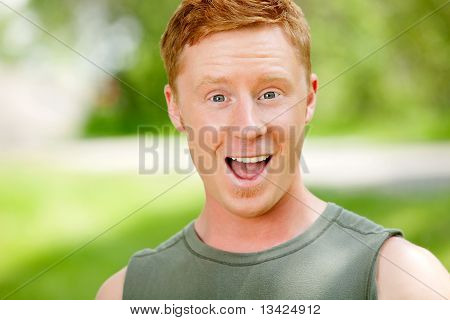 Portrait of excited man with mouth open