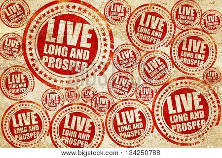 live long and prosper, red stamp on a grunge paper texture