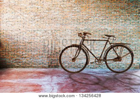 old bicycle with brick wall in room
