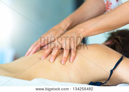 Shiatsu back massage to a woman by a professional