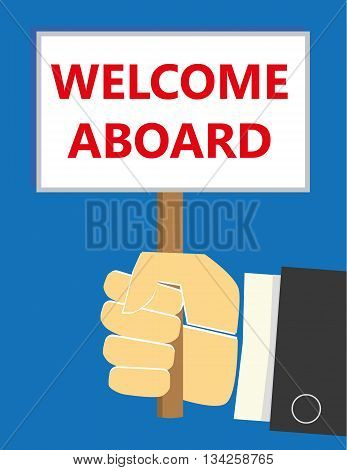 Hand in a business suit holding up a small placard with the words Welcome Aboard added in red text