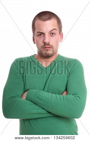 wary young man with raised eyebrow isolated on white