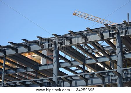 building under construction with blue sky as background