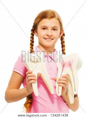 Young 13 years old girl studying structure of the tooth, isolated on white background