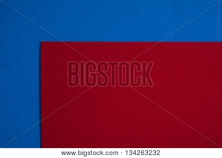 Eva foam ethylene vinyl acetate smooth red surface on blue sponge plush background
