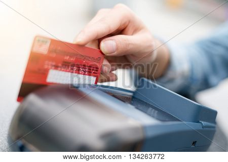 Debit card swiping on card reader device