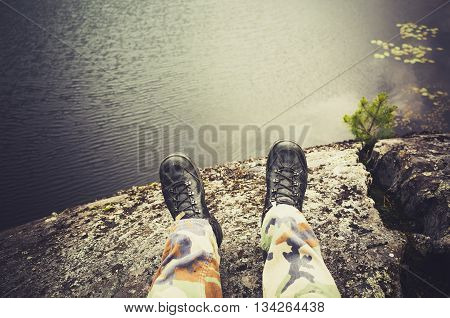 Male Feet In Camouflage Pants And Black Shoes