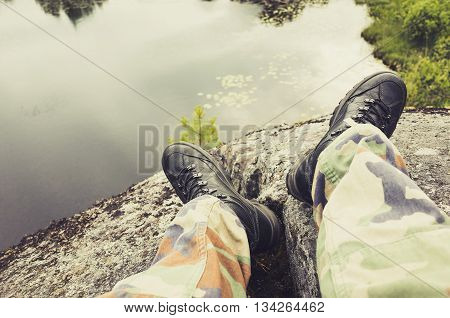 Male Feet In Camouflage Pants And Rough Shoes