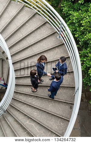 Top view of business people standing on stair