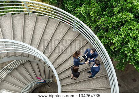 Top view of business people standing at step