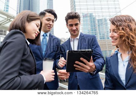 Group of buisness people working on tablet