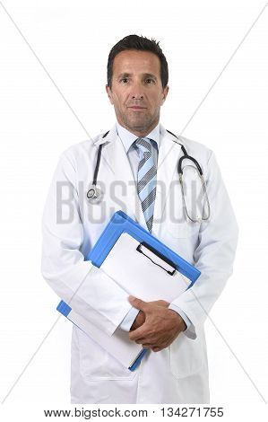 corporate portrait of confident 40s attractive male medicine doctor with stethoscope on shoulders and medical gown standing proud and serious holding clipboard isolated on white background