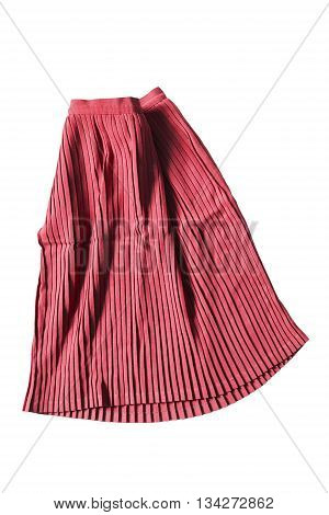 Red pleated skirt folded on white background