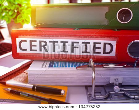 Red Office Folder with Inscription Certified on Office Desktop with Office Supplies and Modern Laptop. Certified Business Concept on Blurred Background. Certified - Toned Image. 3D Render.