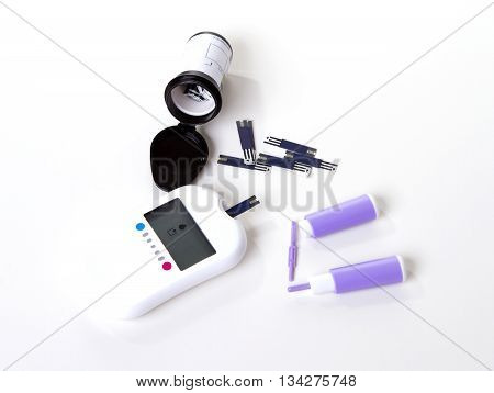 Diabetes composition glucometer measuring glucose level blood test using small drop of blood from finger and test strips.