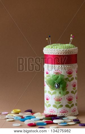box with many pillow for needles and buttons. needlework. sewing. the photo