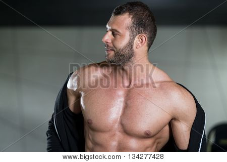 Ripped Young Man In Modern Fitness Center