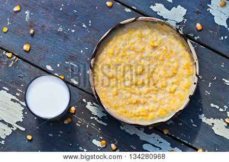 Countryside romanian dessert called pasat (coarsely ground maize with milk and sugar)