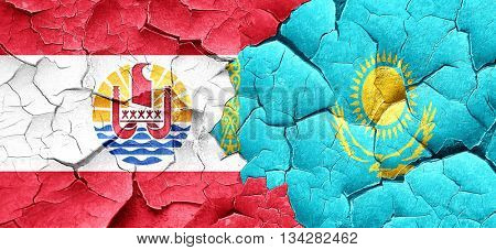 french polynesia flag with Kazakhstan flag on a grunge cracked w